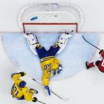 1st place, Sports. Canada's Sidney Crosby fires into the net, just behind Sweden's goalie Henrik Lundqvist, during the men's ice hockey final between Sweden and Canada at the 2014 Sochi Winter Olympics in February. Canada won the Olympic gold.Photo: Joel Marklund (Bildbyrån)/Årets Bild
