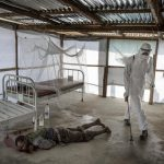 3rd place, News Photo (International). At an Ebola clinic in Bomi, Liberia, the body of David Sakei 50, is sprayed with chlorine. He will soon be buried without relatives at an Ebola victims gravesite.Photo: Niclas Hammarström (Aftonbladet, Kontinent)/Årets Bild