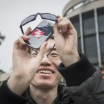 Most people found it was not easy to capture a nice photo of the eclipse, but this young man in Stockholm got creative Photo: TT