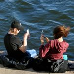 People capturing spring at Norra Hammarbykajen in Stockholm on March 8th.Photo: Hasse Holmberg/TT