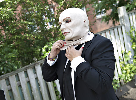 Party members wear matching masks and suits. Photo: Henning Bagger/Scanpix