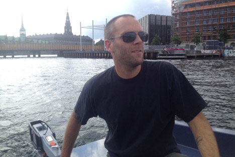 The article's author playing captain on a GoBoat.