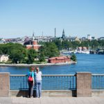Tourists gazing out at Stockholm's blue water.Photo: Jessica Gow/TT