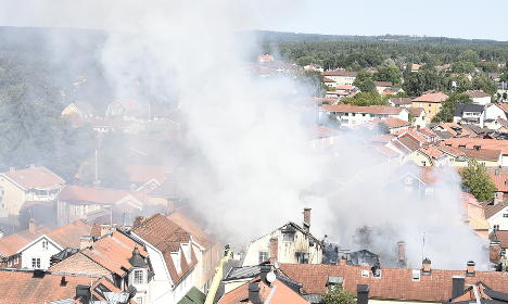 'Out of control' fire threatens Swedish town