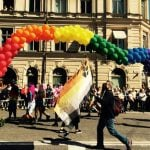 Marchers carry a rainbow made of balloons.Photo: Sophie Inge