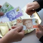 Sweden slashes interest rate to new record low