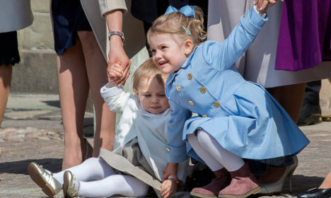 Estelle pulling her younger cousin Princess Leonore to her feet at King Carl XVI Gustaf's 69th birthday celebrations in April 2015.Photo: Jonas Ekströmer/TT