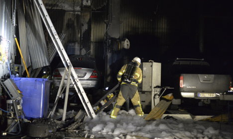 Firefighters tackle two burning buildings