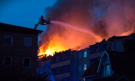Fire rips through apartment block, 157 homes evacuated
