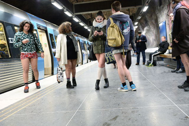 In pictures: Swedes celebrate 'no pants' subway ride in freezing cold