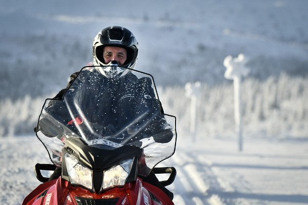 Forget about Obama kitesurfing! This is Sweden's Prime Minister racing on a snow scooter