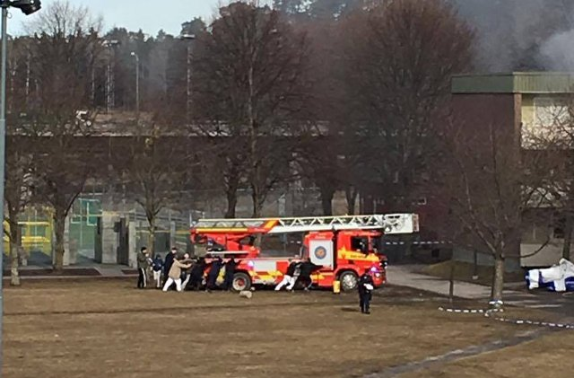 Viral photo of locals helping firefighters 'shows positive side' of Stockholm suburb