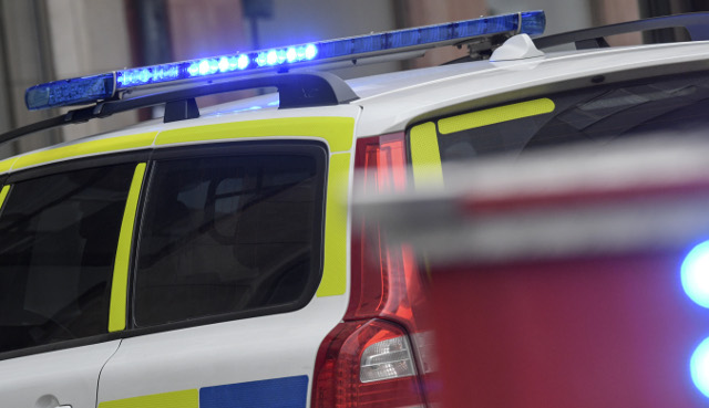 Police car flips after officers are attacked in Uppsala