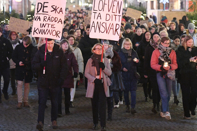 Demonstrators call for Swedish government to do more to combat rape