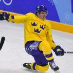 Sweden advances to Olympic hockey quarter-finals