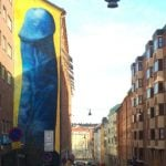 Giant blue penis painted on Stockholm apartment building