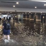 IN PICTURES: Swedes go for a swim in rail station underpass after torrential rain caused floods