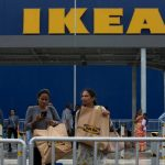 Customers return after shopping at Ikea's first store in India.Photo: AP Photo/Mahesh Kumar A