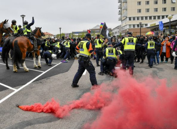 Neo-Nazi march attacked by counter-demonstrators in Sweden