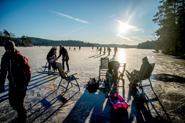 people on an ice-covered lake