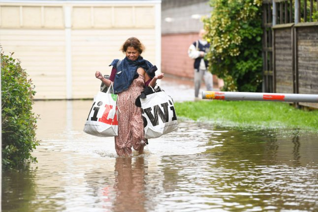 IN PICTURES: Roads cave in after heavy rain batters central Sweden