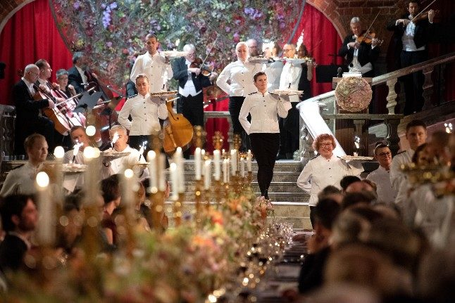Waiting staff serve guests at the glittering prize ceremony and banquet held in Stockholm for the science and literature laureates will not happen this year due to the pandemic. The banquet will not take place this year.